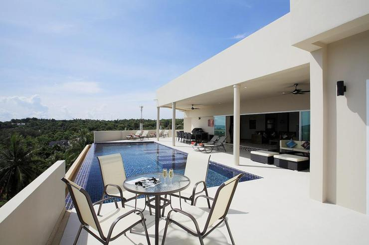 Diamond View (V05) - Large sun terrace surrounding the 12 x 5 metre swimming pool