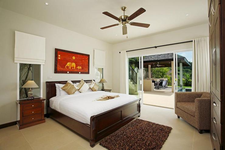 Bedroom 3, with king size bed, en-suite bathroom and sliding doors to the outside sun deck and swimming pool