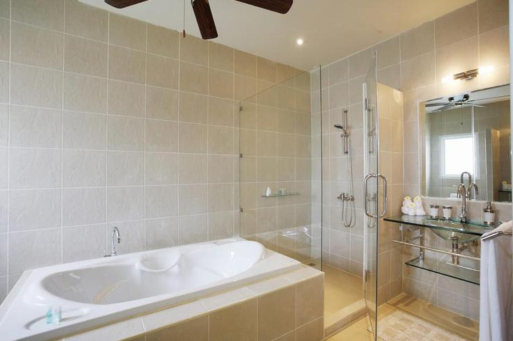 Large master en-suite bathroom with bath, walk-in shower and two wash hand basins