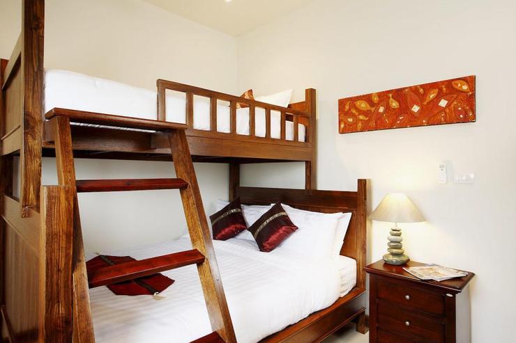 Spacious 2nd bedroom with queen size bed with single bed above, sleeping three guests