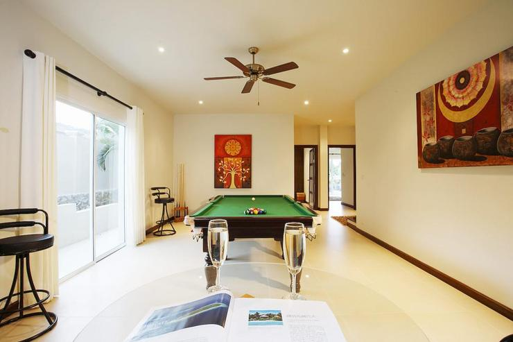 Games room with pool table and gym equipment