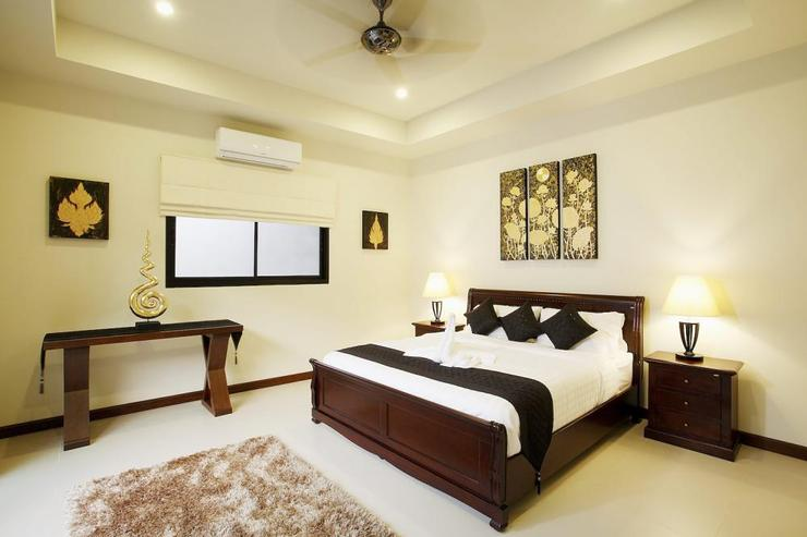 Master bedroom suite with king-size bed and large master bathroom, air conditioning and ceiling fan