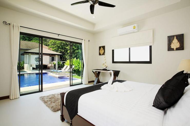 Master bedroom with sliding door offering direct access to the sun deck and swimming pool