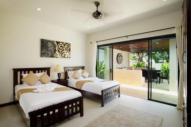 Bedroom 3 with sliding door access to private swimming pool and sundeck