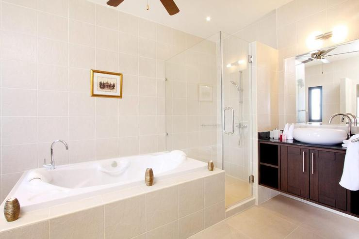 Opal Villa (V11) - Master bedroom en-suite bathroom with large bath, walk in shower and two basins