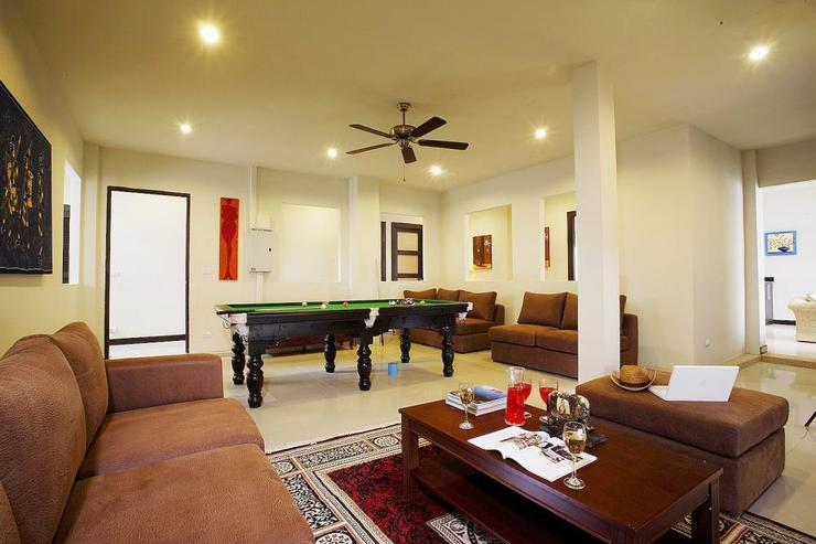 Spacious games room with soft seating, darts board and pool table