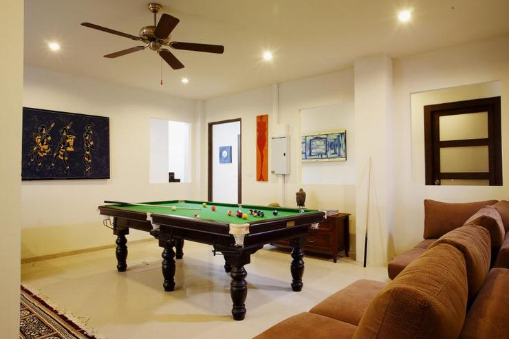 Large games room with pool table and soft seating