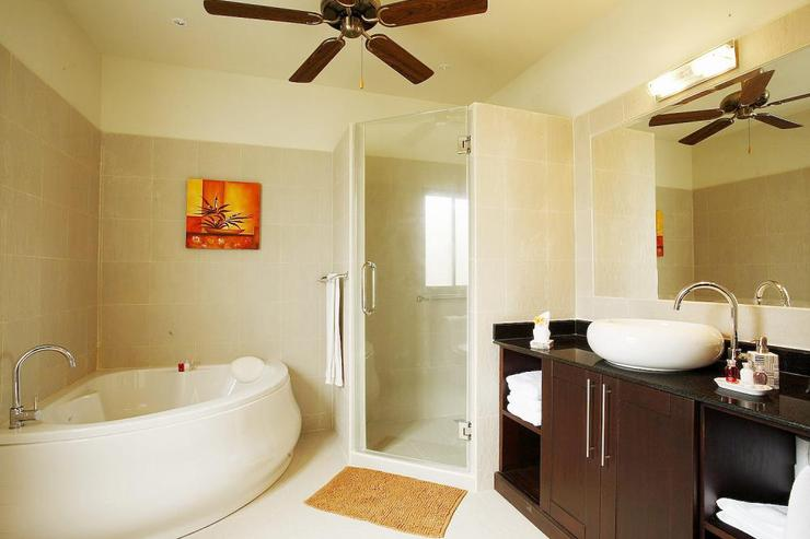 Master en-suite bathroom with feature corner bath and walk in shower