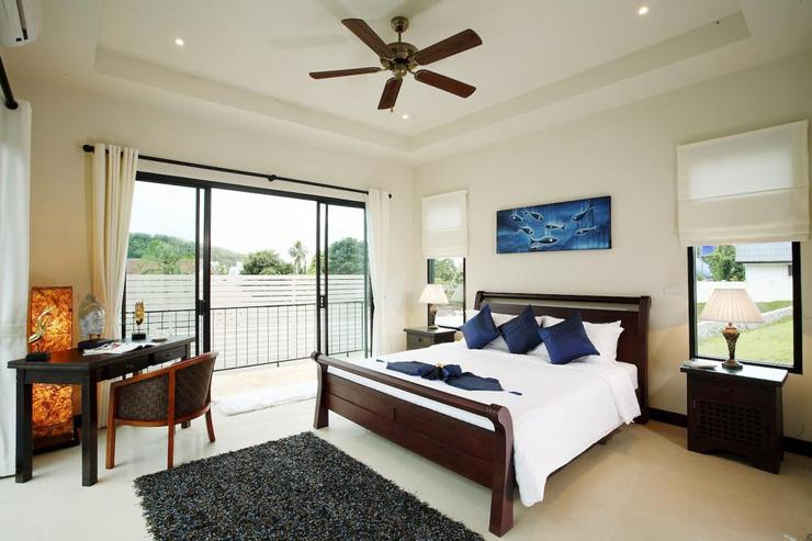 Bright and airy master bedroom with sliding doors on two sides, air conditioning and ceiling fan