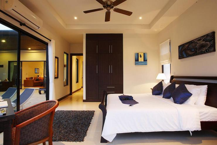 Pearl Villa (V12) - Bedroom 2 with direct pool access and shared bathroom with bedroom 3