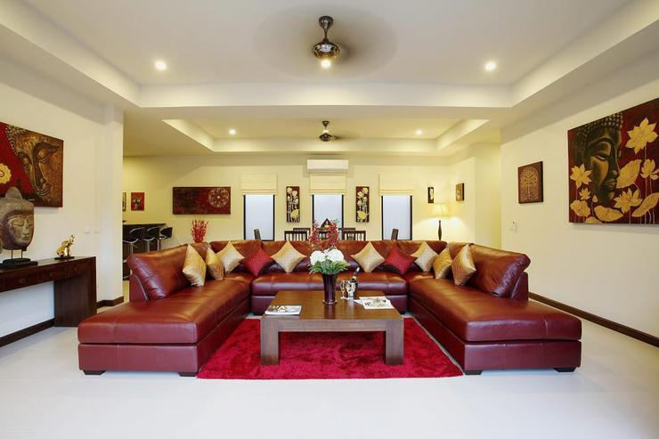 Large leather sofa invites guest to the open plan living room