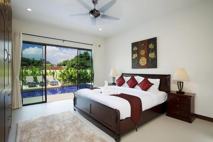 Ruby Villa - Sliding doors in bedroom 2 again open onto the swimming pool and sundeck