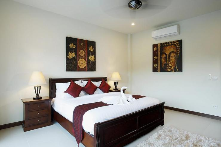 Bedroom 2 with king-size bed, air conditioning, ceiling fan and crisp white bed linen
