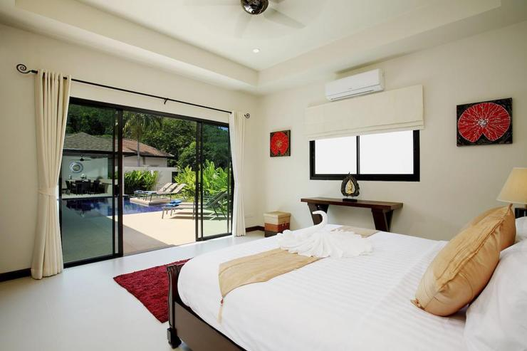 Sliding doors from the master bedroom open directly onto the swimming pool