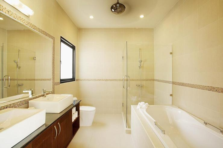 Large en-suite master bathroom with bath and shower