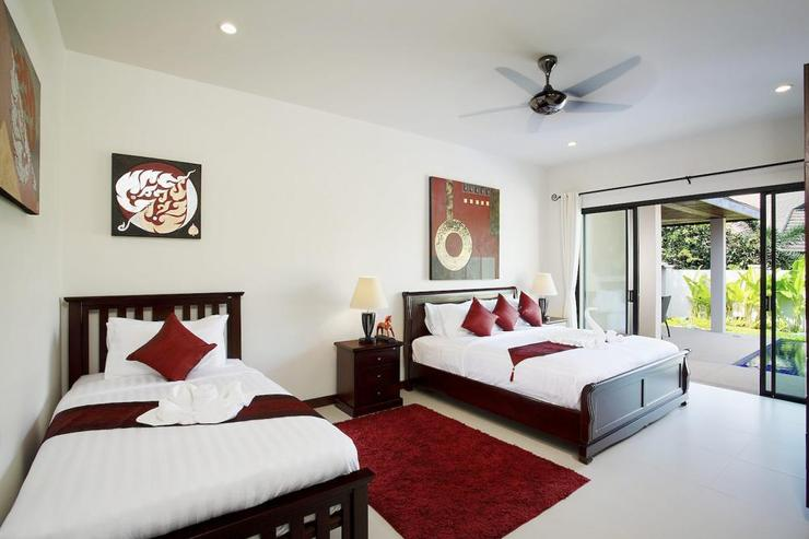 The third bedroom (sleeping 3 people) also has direct access to the swimming pool through sliding doors