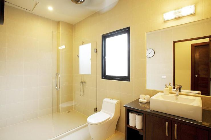Second Private bathroom with large walk in shower, designed for guests using bedroom 2 and 3 to share