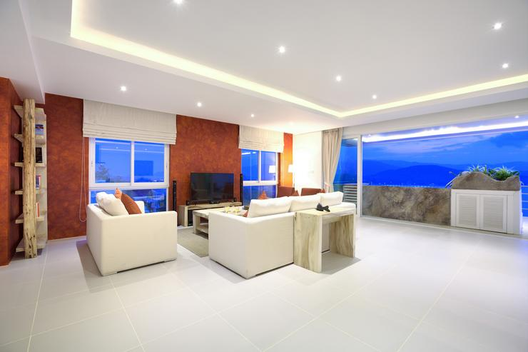 Seating / lounge area with a large LED flat screen TV and multiple satellite channels