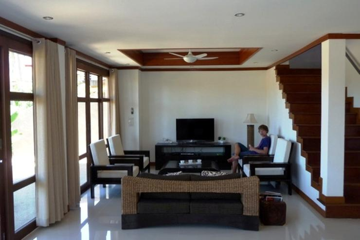 Large lounge / living area with satellite TV