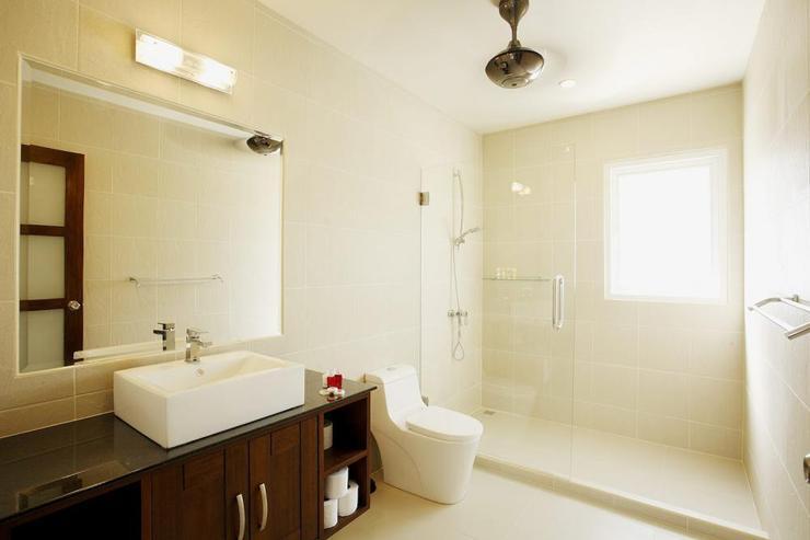 Master bedroom suite en-suite bathroom with large walk-in shower