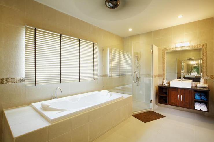 Master en-suite bathroom complete with bath, walk in shower and twin wash hand basins