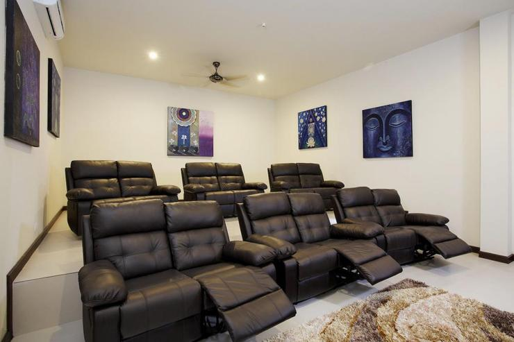 12-seater cinema room with reclining chairs and big screen projector