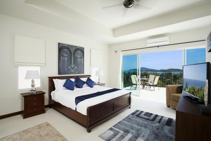 Bedroom 4 with king-size bed, en-suite bathroom, flat screen TV, and direct access onto upper balcony with seaviews