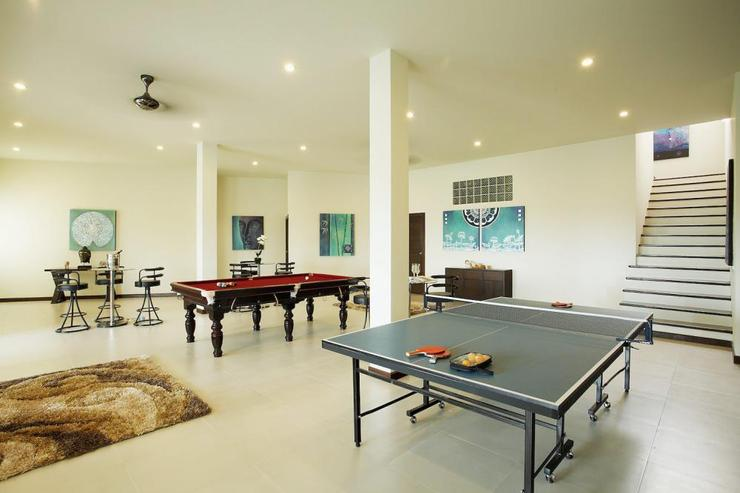 Extensive games room with table tennis table, pool table, bar area and gym equipment