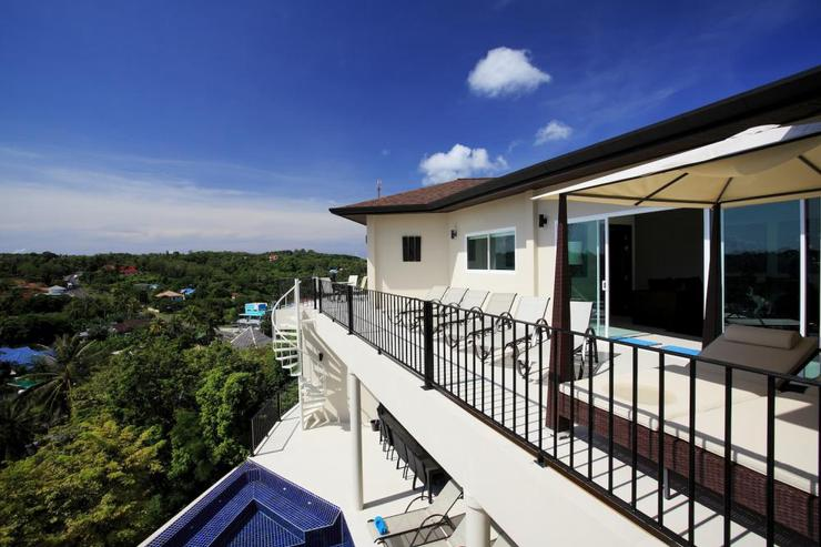 The upper balcony is located above the infinitiy-edge swimming pool and lower sundeck
