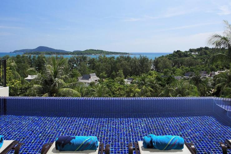 Infinity-edge swimming pool with integral jacuzzi, overlooking the Andaman Sea
