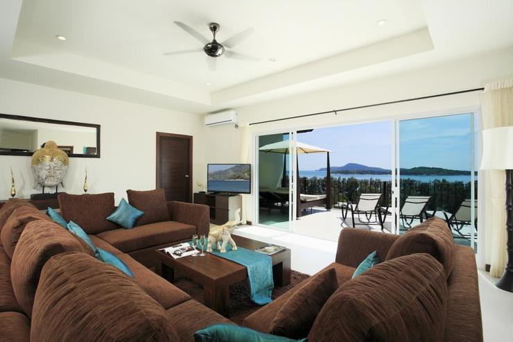 Second living room, on the upper level, leading onto balcony with stunning sea views