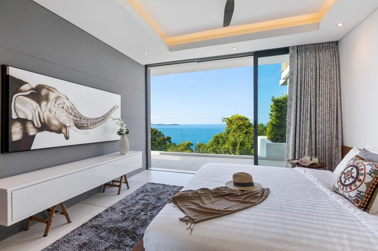 Villa Veasna - Resplendent floor-to-ceiling siding glass doors open widely on a covered balcony to let you relax with the soft sea-breeze by the bedroom